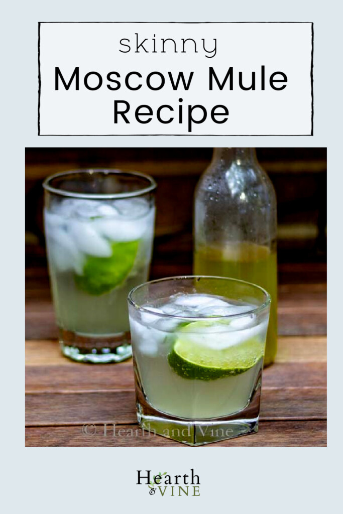 Small and tall glasses of skinny moscow mule drinks and a bottle of ginger syrup.