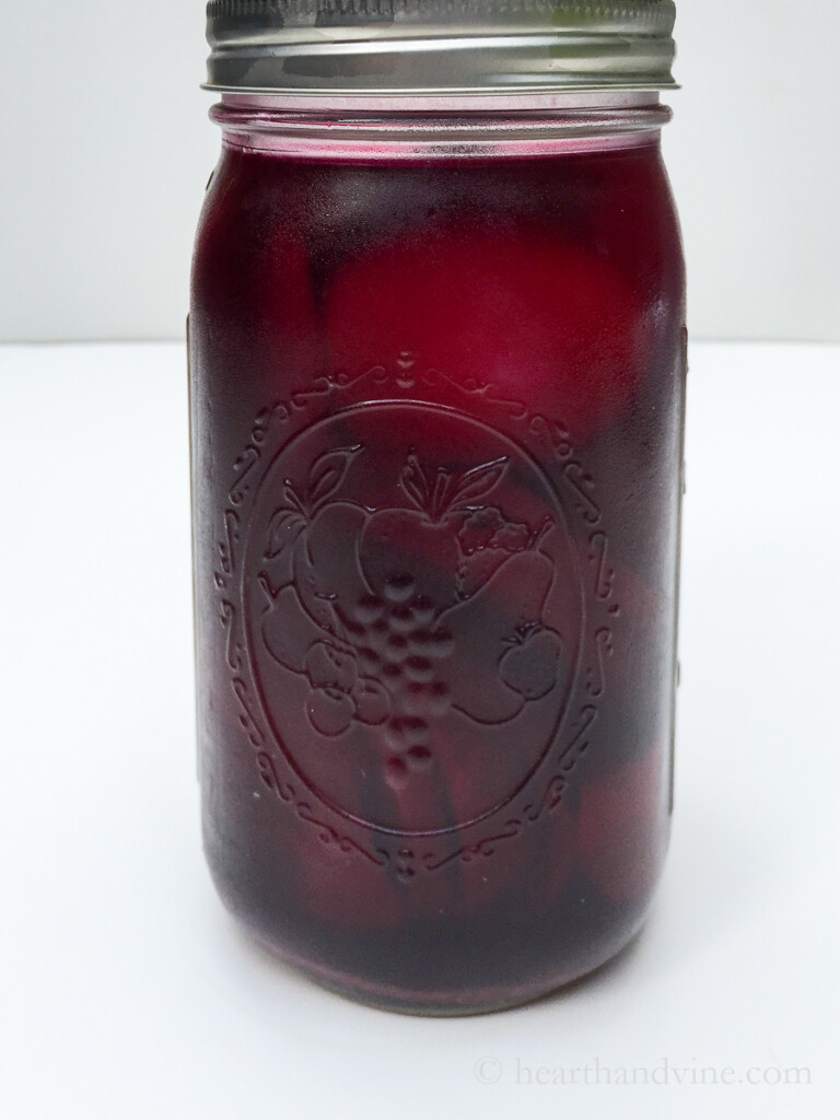 Amish pickled eggs and beets in a mason jar.