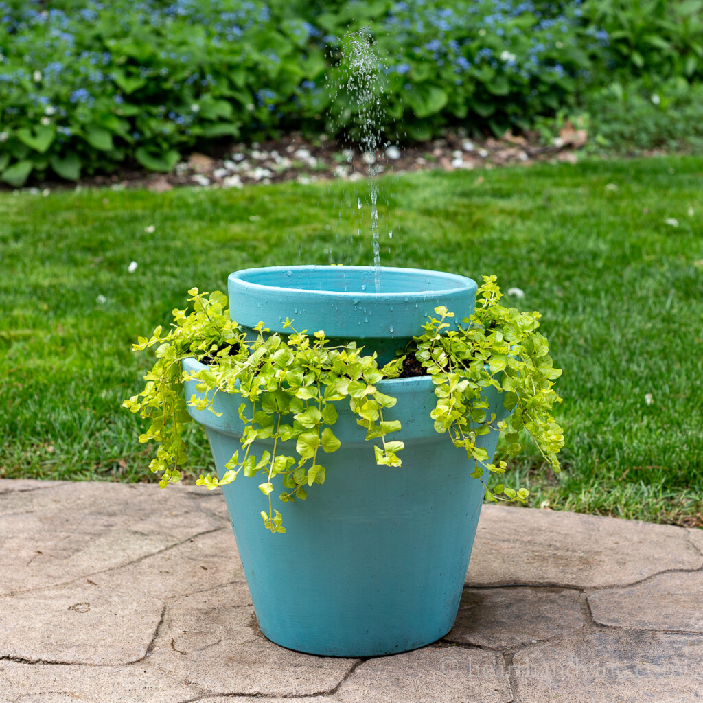 Homemade solar water fountain that doubles as a planter from clay pots.