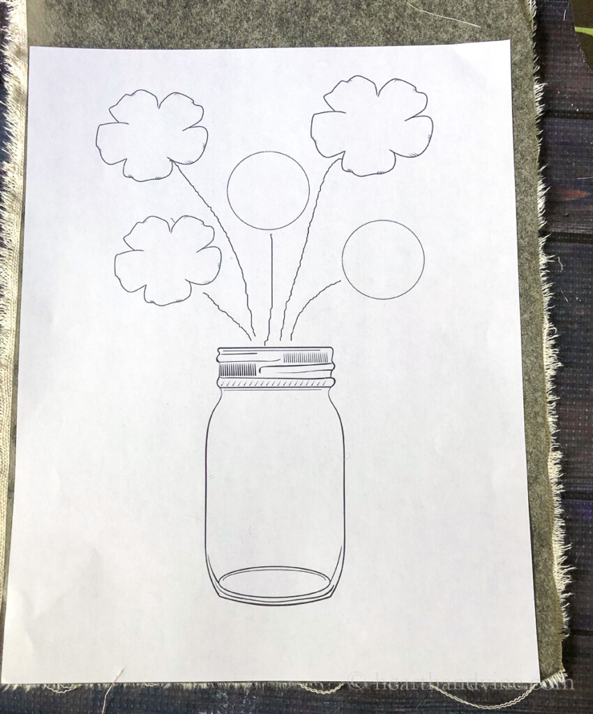 Mason jar vase with flower graphic traced with carbon paper on canvas fabric.