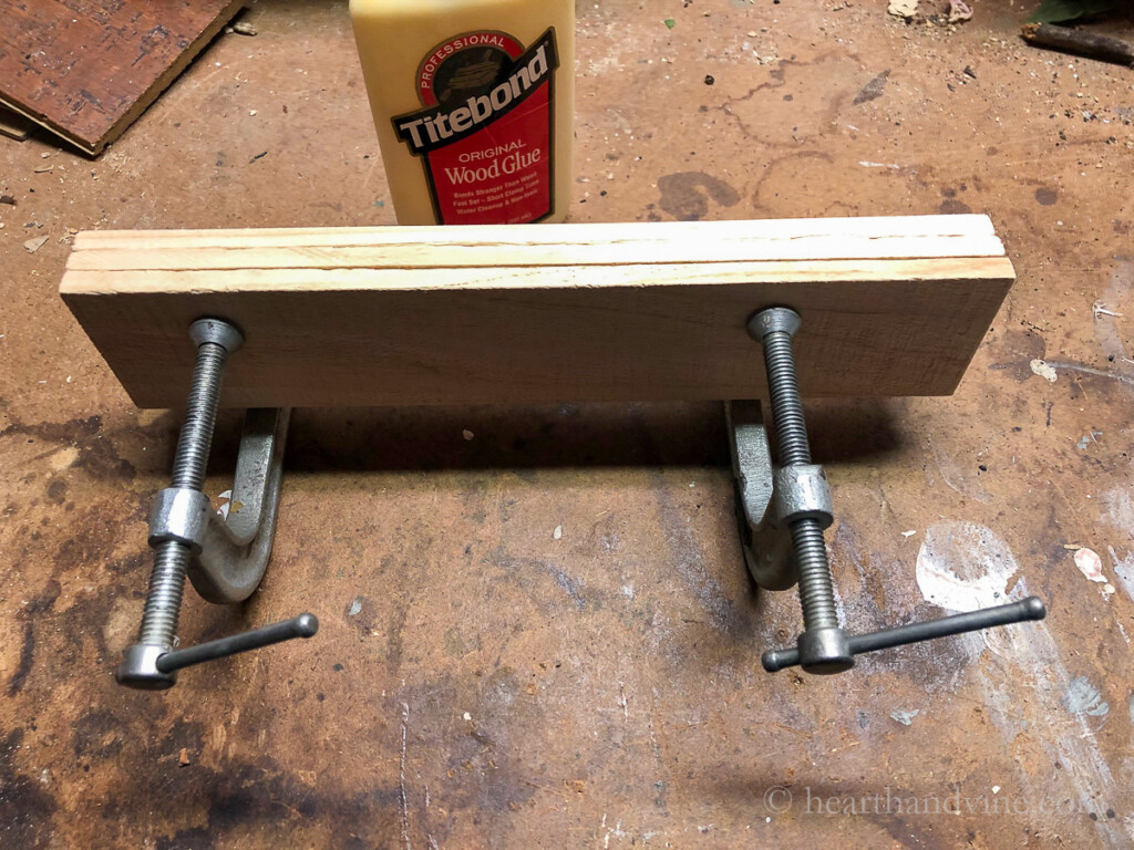 Clamping wood pieces together with C clamps.