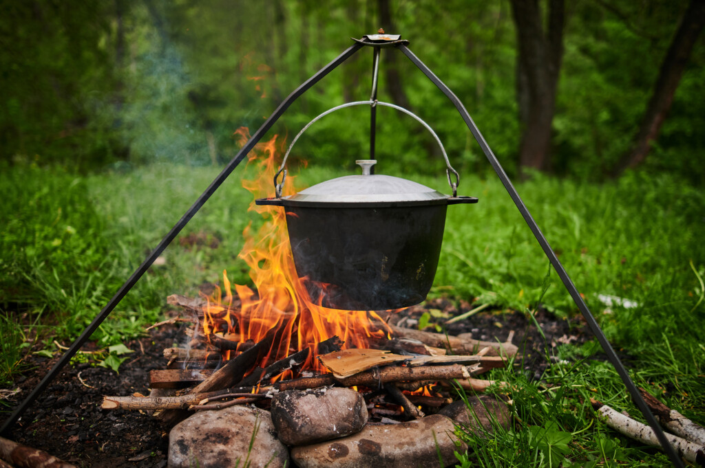 Black pot cooking on a campfire.