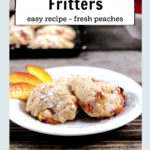 Two baked peach fritters on a plate with sliced peaches
