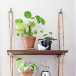 Two wooden shelves hanging with rope.