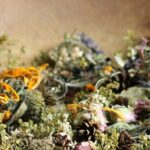 Large wooden bowl with dried flower potpourri.