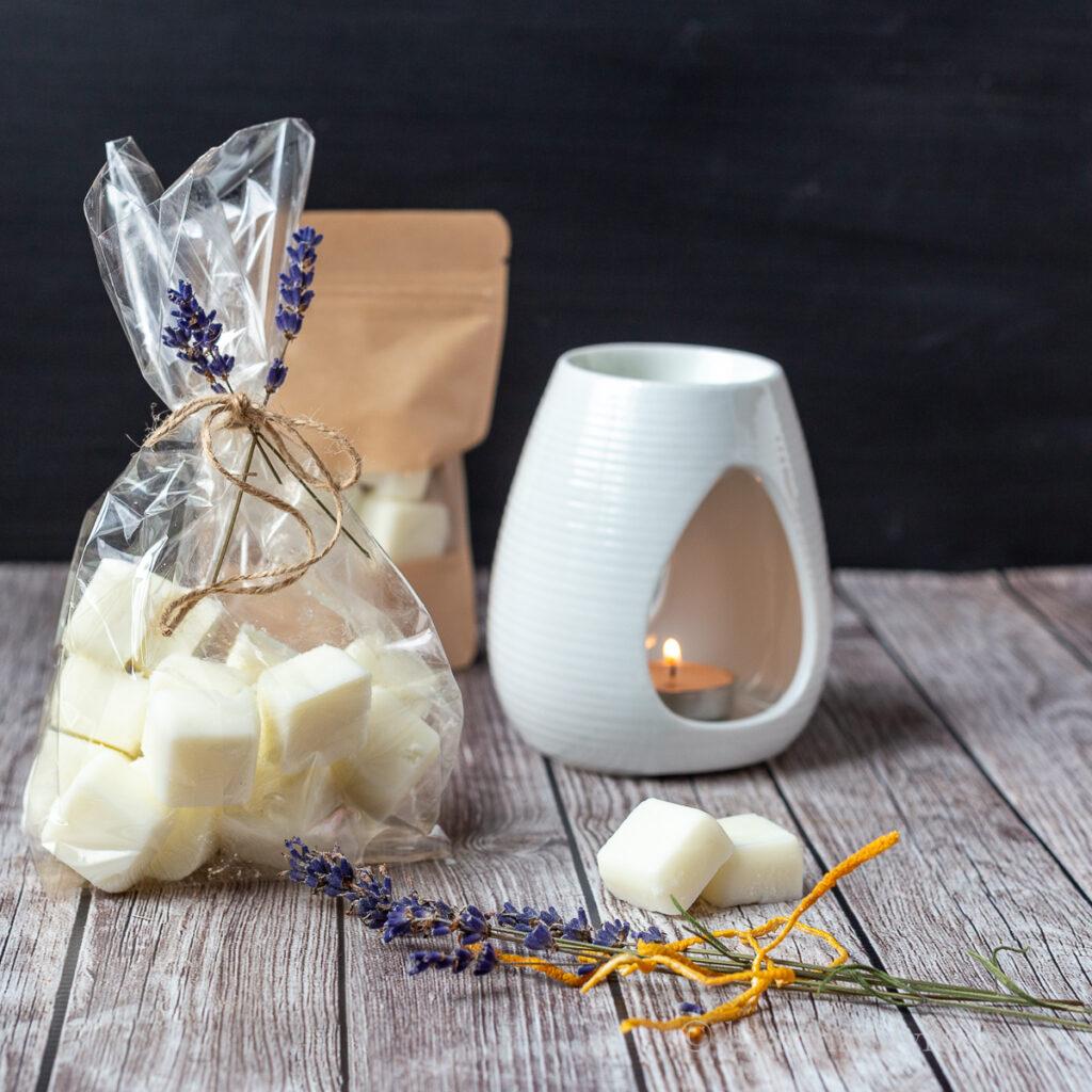 Wax burner, bag of wax melts, dried lavender and lemon peel.