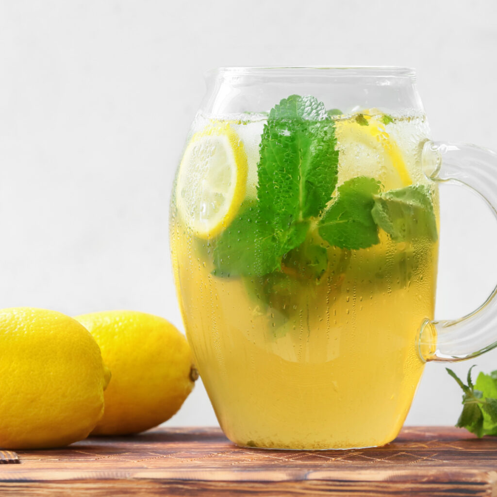Pitcher of herbal mint tea with lemon