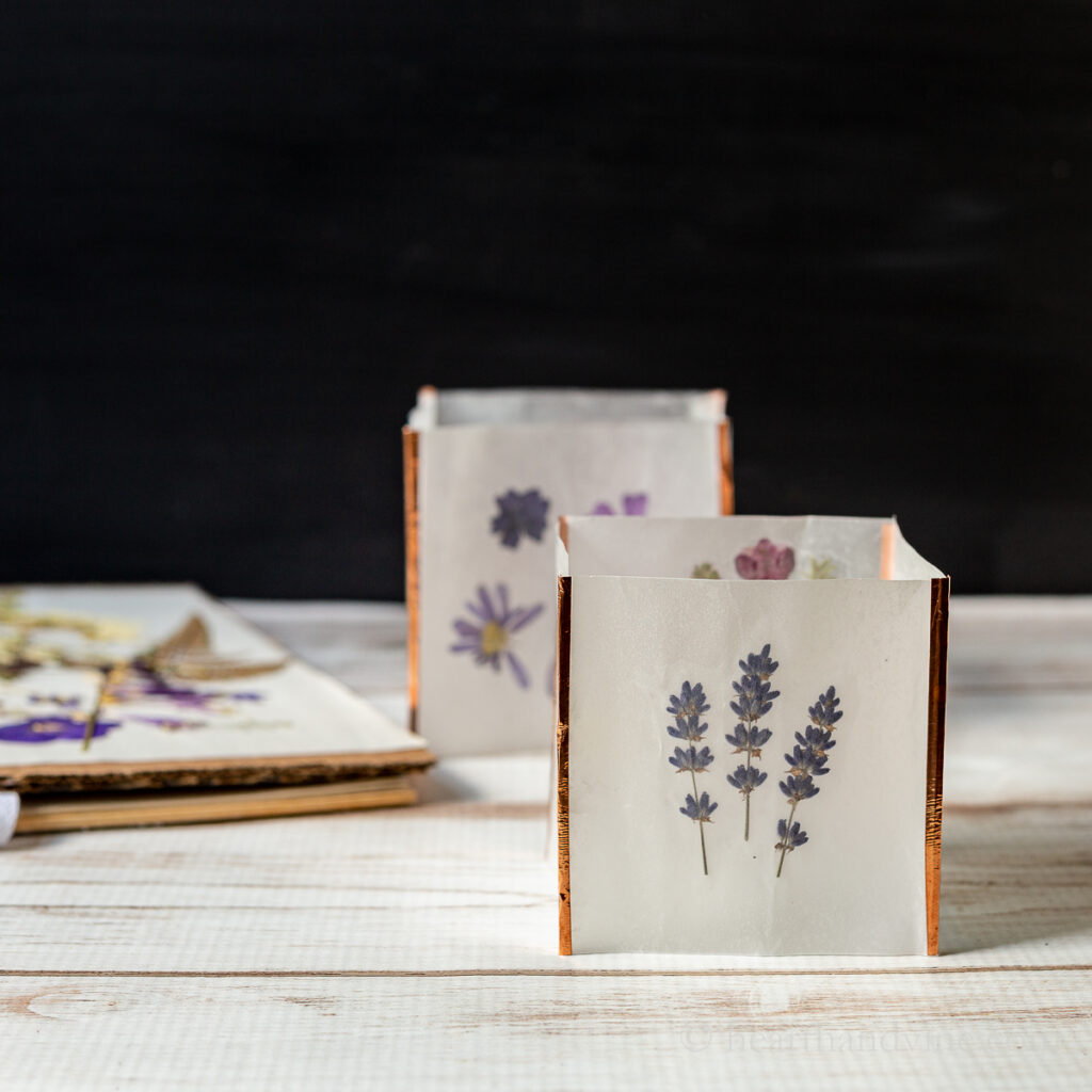 Pressed flower luminaria with lavender flowers.