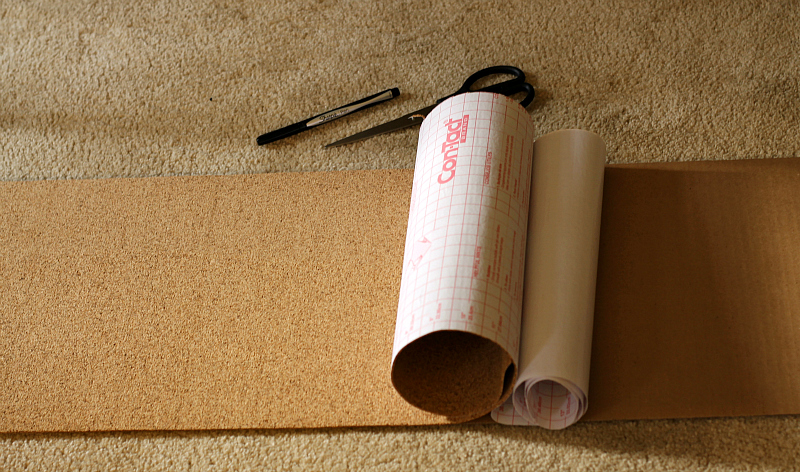 Cork shelf liner paper with some of the backing removed.