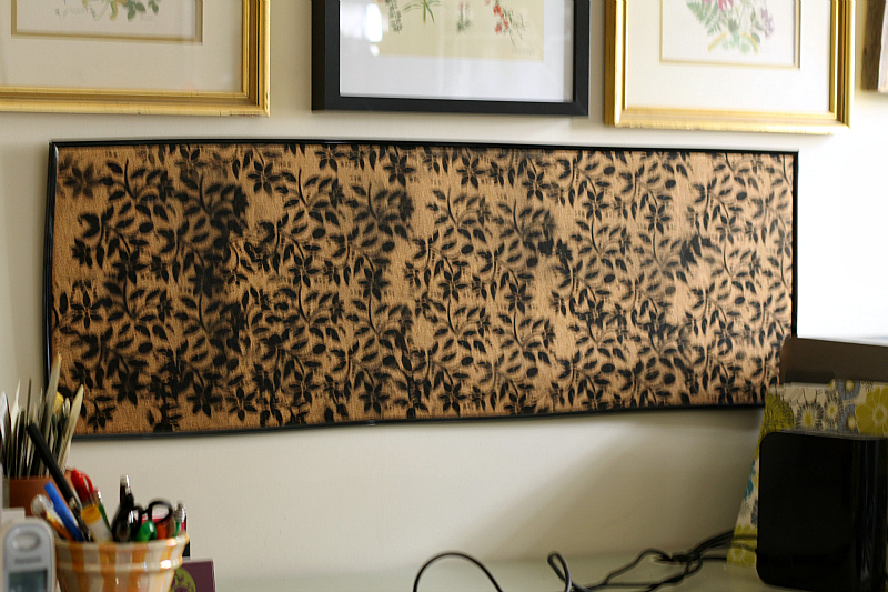 Black floral printed bulletin board hung on the wall.