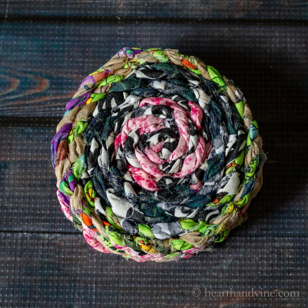 A stack of multi-colored fabric twine.