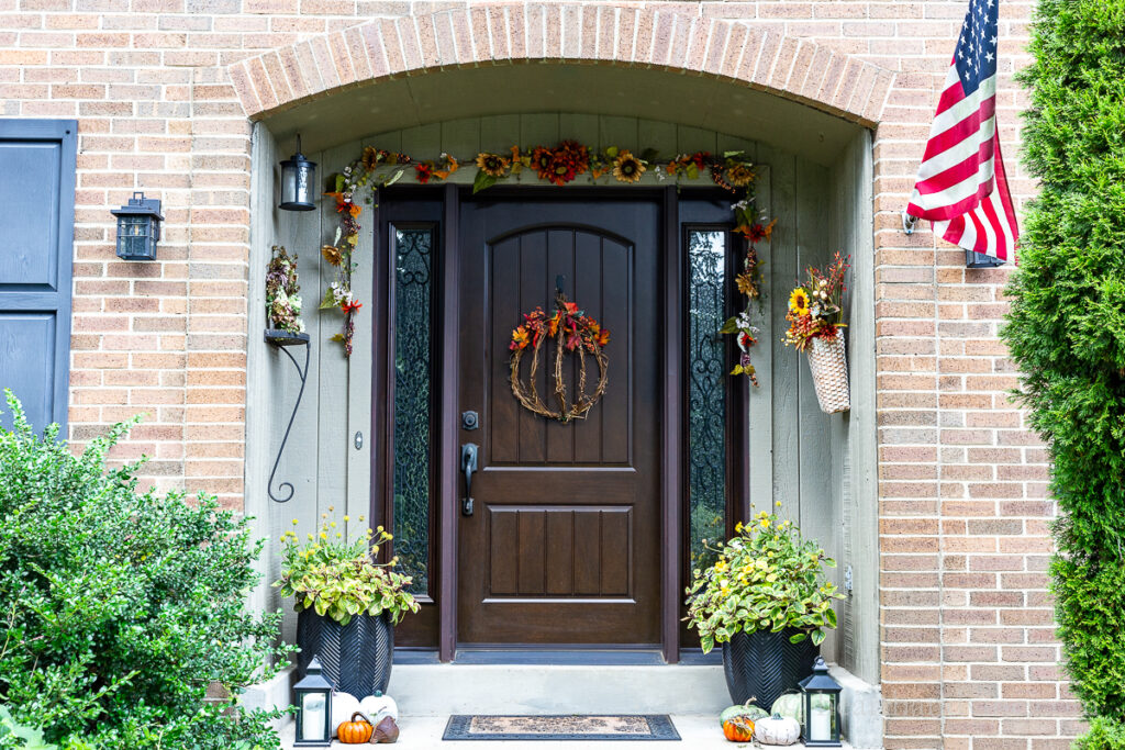 Full view of fall decorated front porch