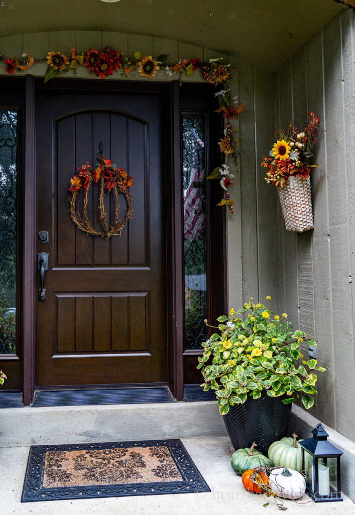Right side of fall front porch decorations.
