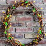 Faux bittersweet vine wreath on mantel