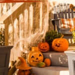 Fall porch stairs with pumpkins and other decorations