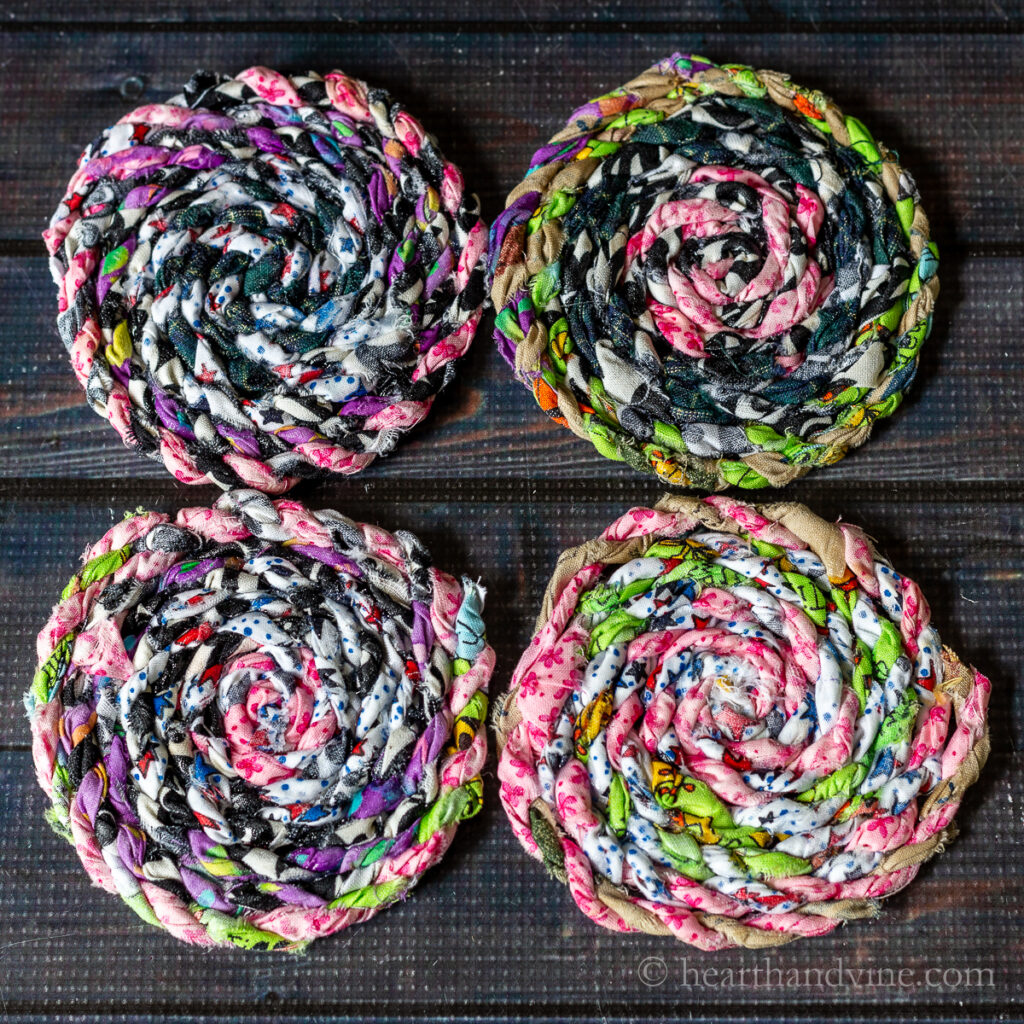 Four colorful fabric coasters made from fabric twine.