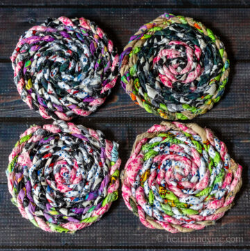 Four colorful fabric coasters made from fabric twine
