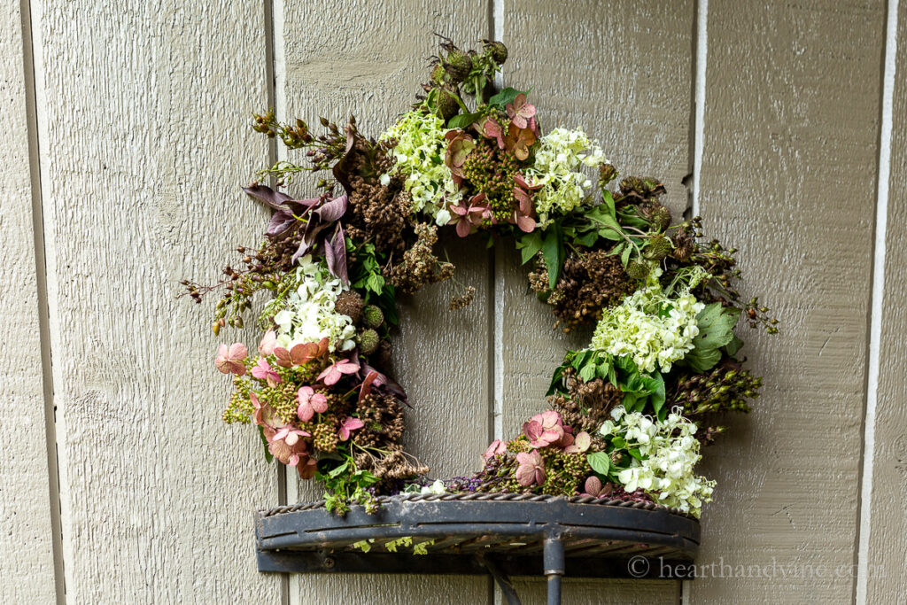Fresh flowers, seed pods and foliage wreath.