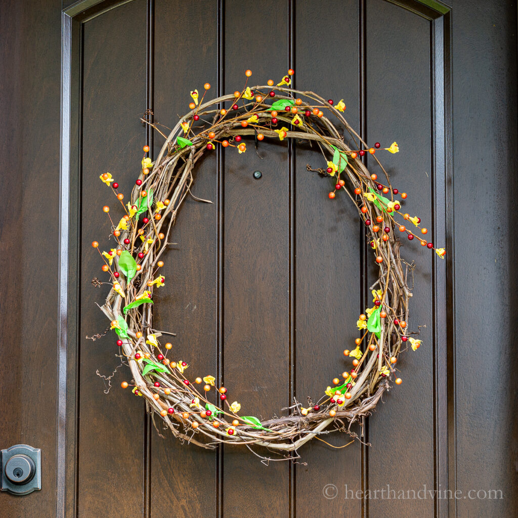 Fall bittersweet and grapevine wreath on front door.