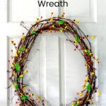 Faux bittersweet wreath on white door.