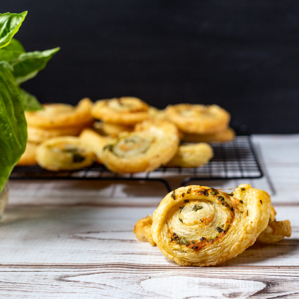 Baked pinwheels made with herbs and puff pastry.