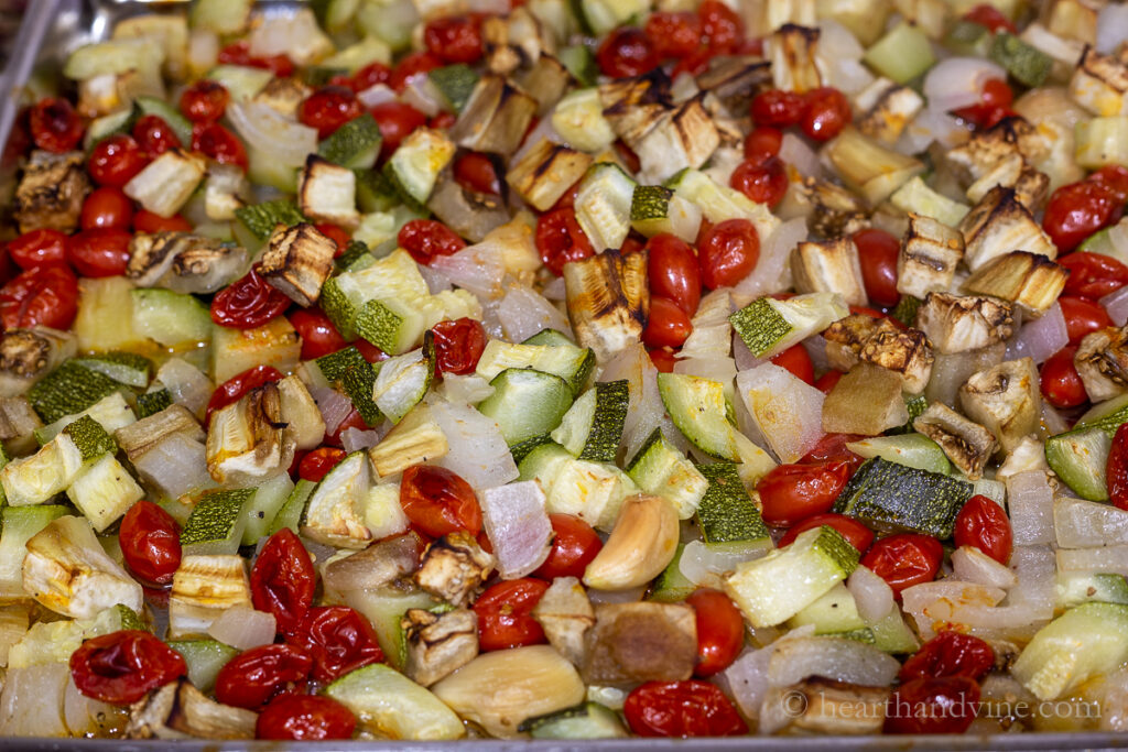 Roasted grape tomatoes, zucchini, onions and eggplants pieces.