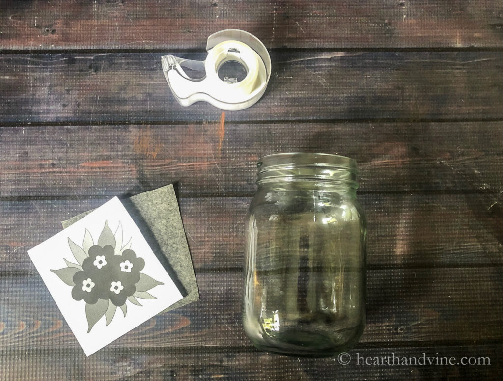 Pint mason jar, floral pattern, carbon paper and tape.