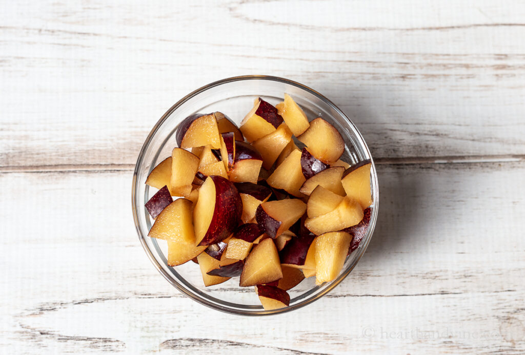 Chopped fresh black plums.