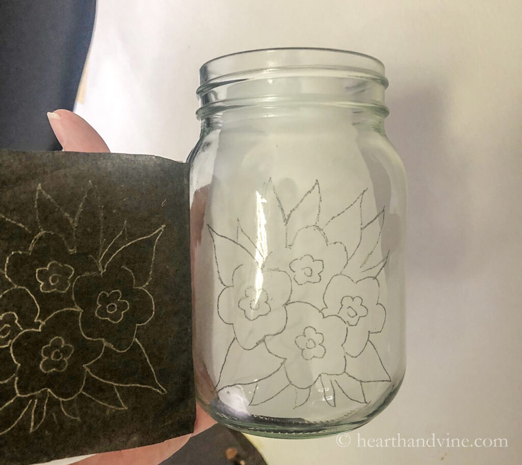 Floral pattern transferred onto a mason jar with carbon paper.