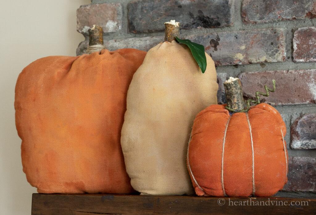 Primitive fabric pumpkins on the mantel.