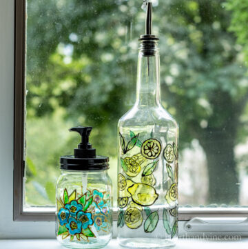Stained glass bottle painting on a tall bottle and shorter soap dispenser
