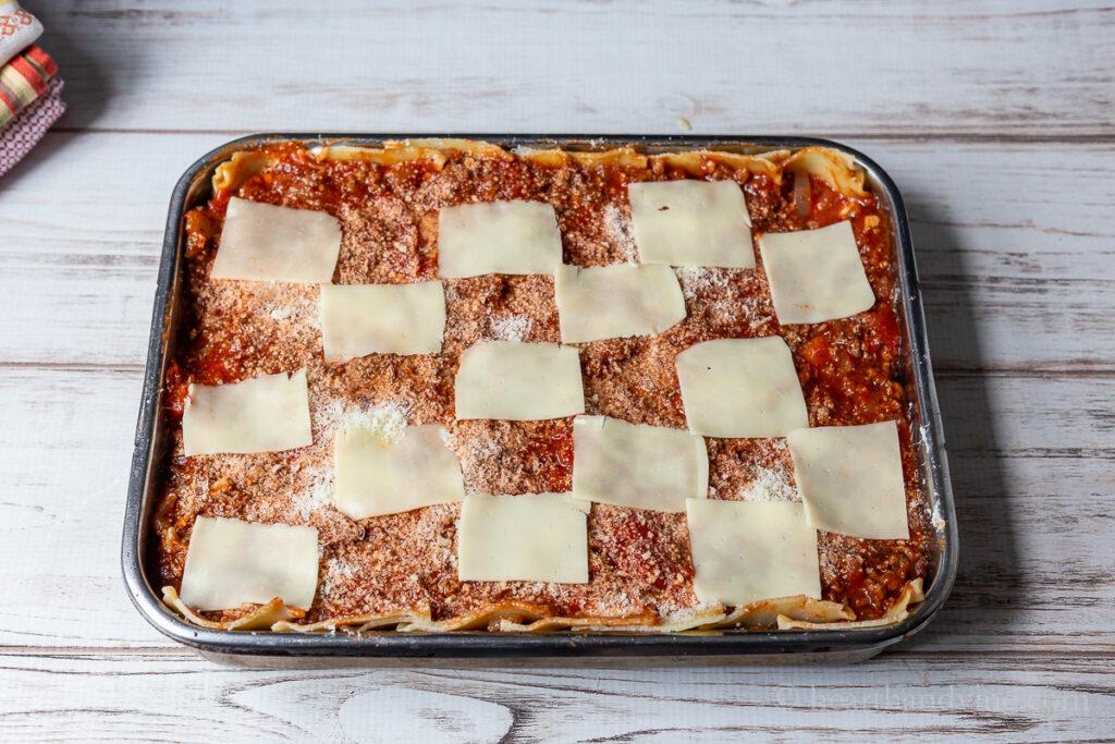 Lasagna recipe in a large pan before baking.