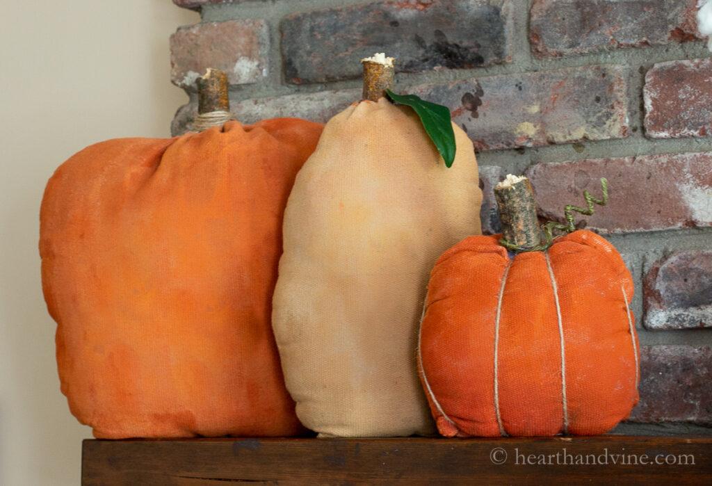 Trio of primitive fabric pumpkins on the mantel.