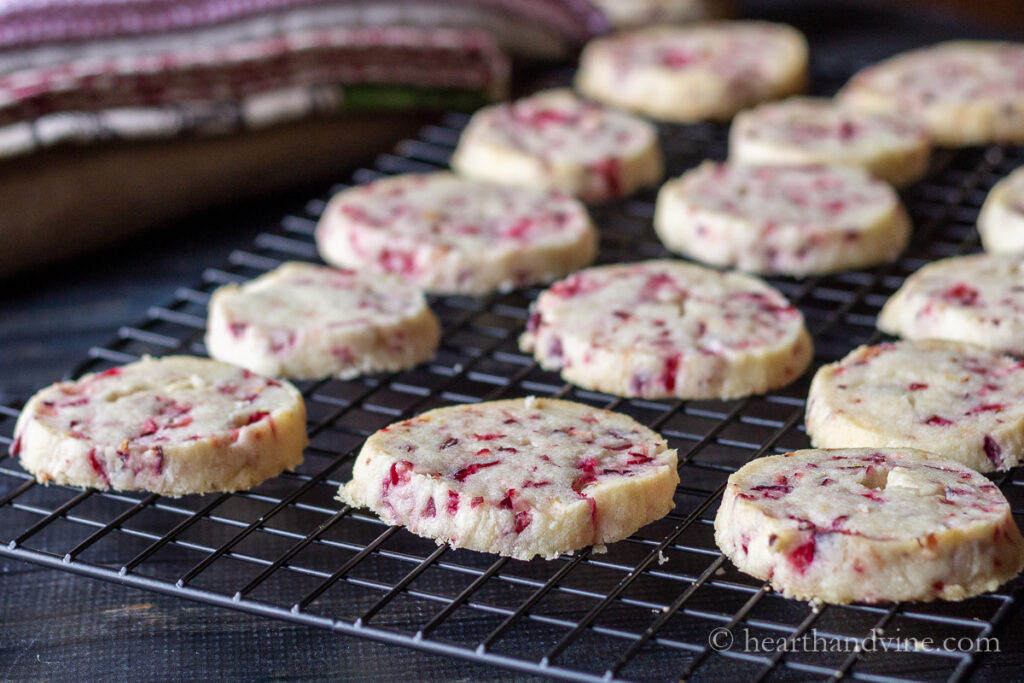 Baked fresh cranberry shortbread cookies on a cooling rack.