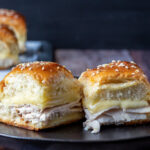 Two turkey ranch slider sandwiches on a plate.