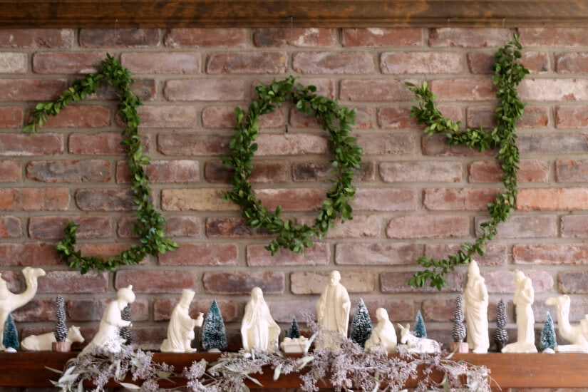 Wire hanger boxwood letters tutorial hung above the mantel
