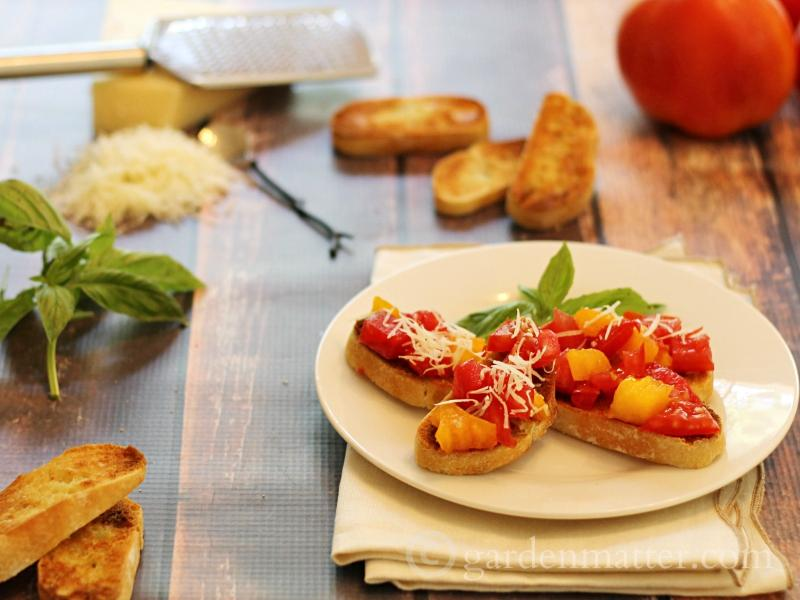 Learn why you want to use both red and orange tomatoes to make this simple summer tomato bruschetta recipe. It's one you will want to make over and over again.