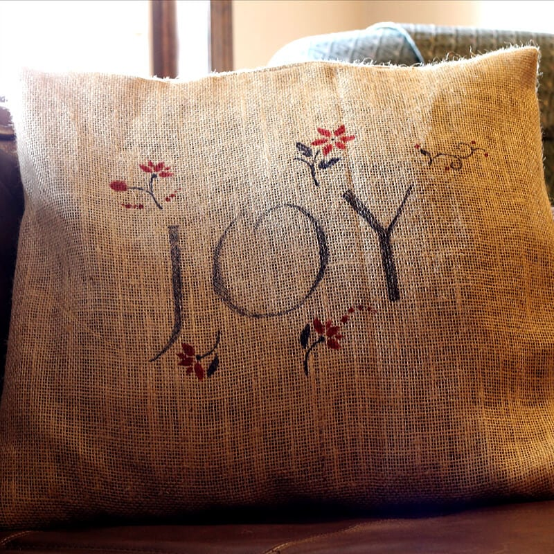 This project for holiday burlap pillow covers is really easy and I'll show you two tricks that you can use in the future for any time of year.