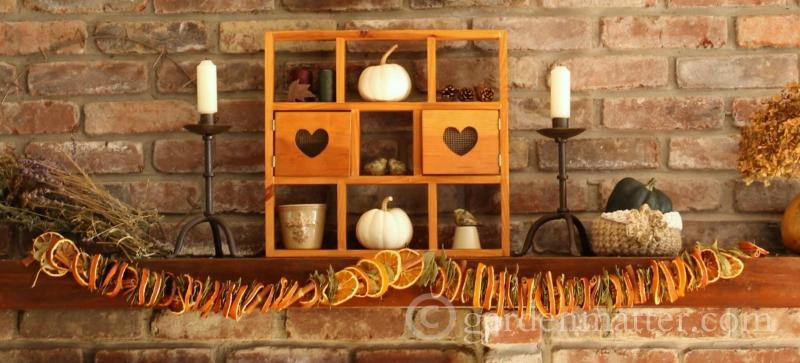 Dried orange garland for your fall mantel.