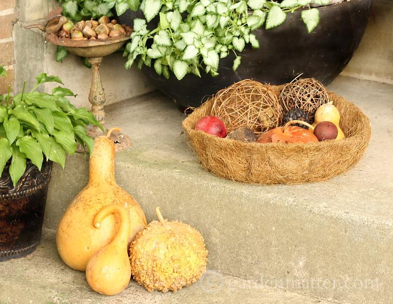 Gourds, acorns and orbs on porch