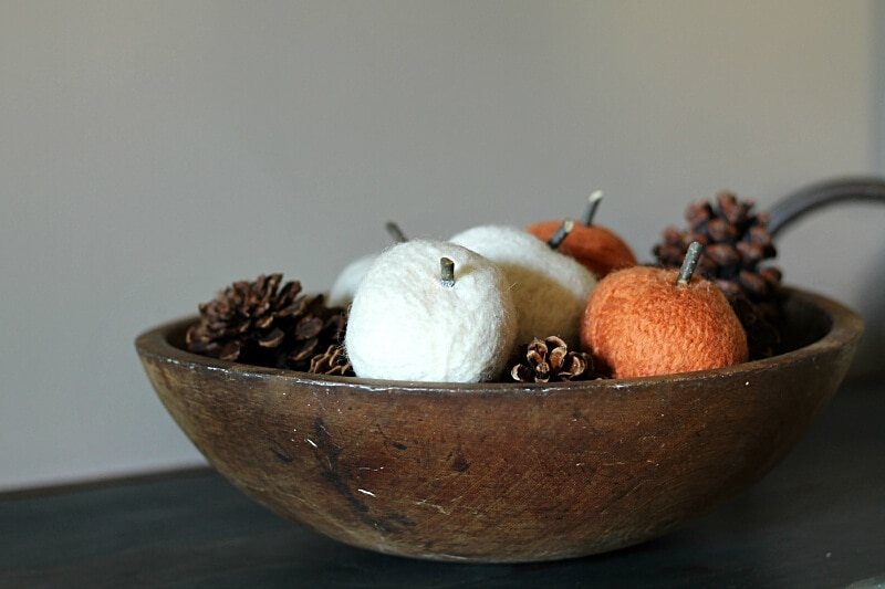 Bowl with pinecones and dryer ball pumpkins