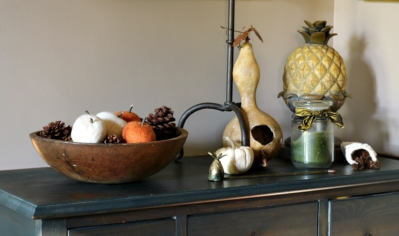 Chest in foyer with gourds and dryer ball pumpkins