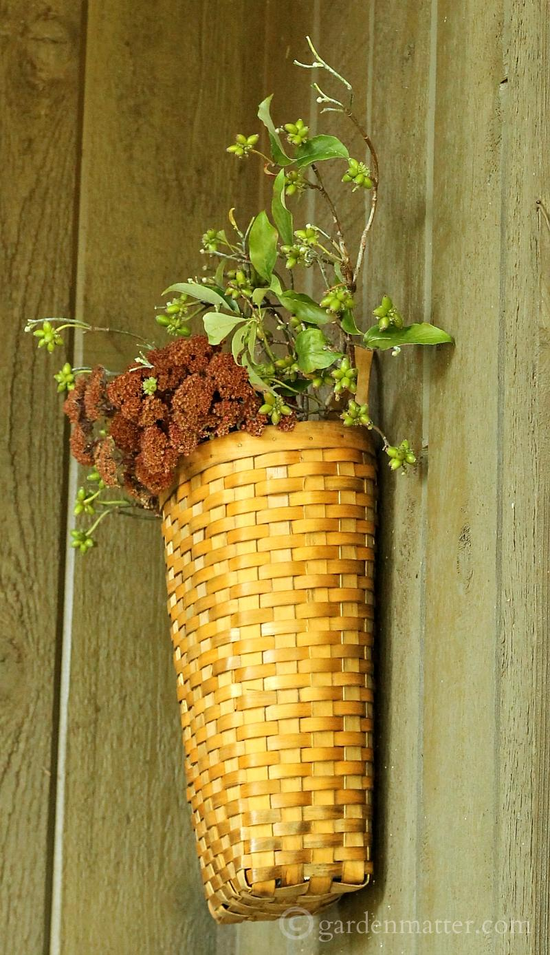 Hanging woven basket with dried flowers