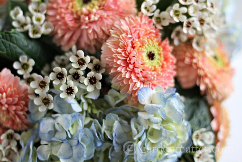 Tight flower arrangement in a mercury glass bowl.