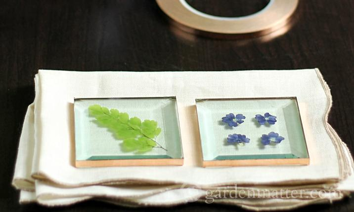 Using square glass and copper tape you can make beautiful coaster from your own flowers in no time and not a lot of money.