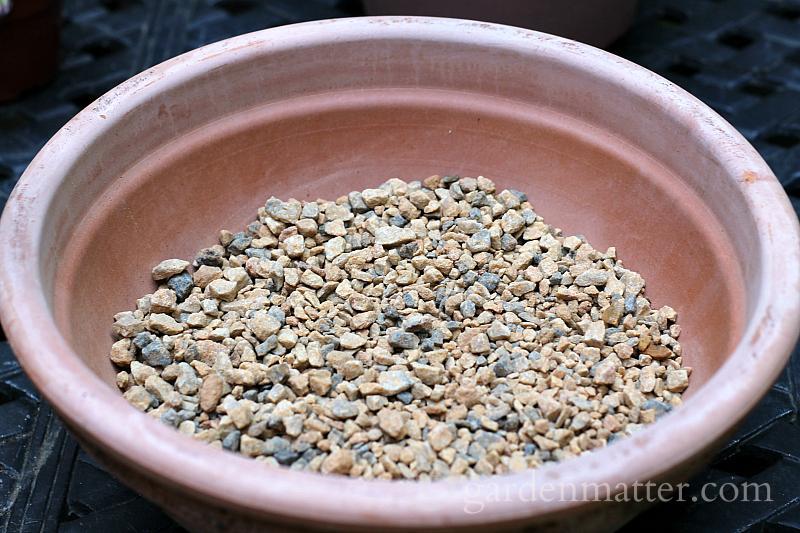 Gravel in bottom of terra cotta planter