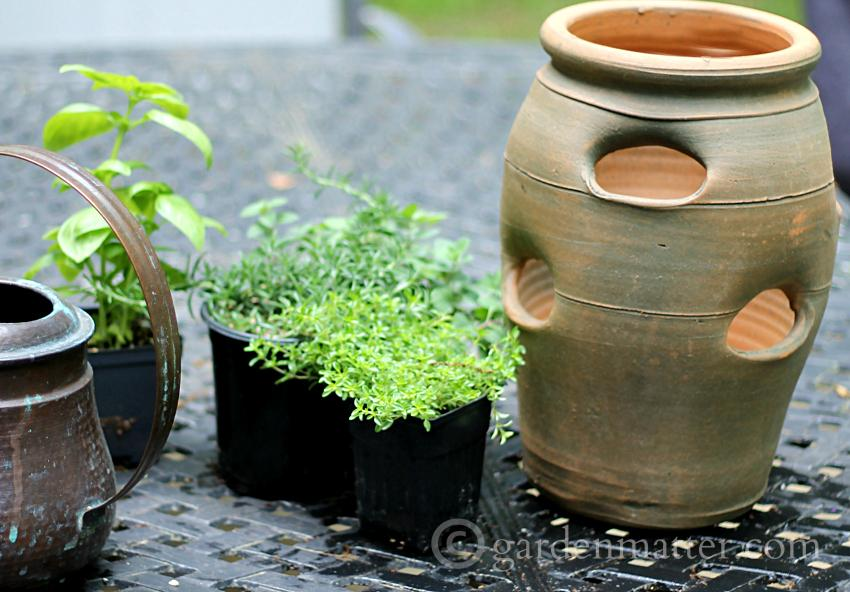 Growing herbs in strawberry pots ~ materials