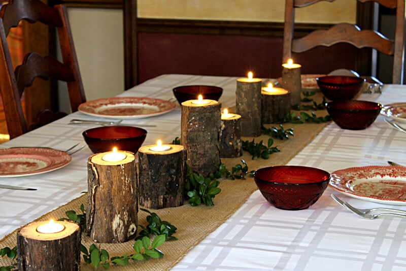 rustic log candlestick on table.