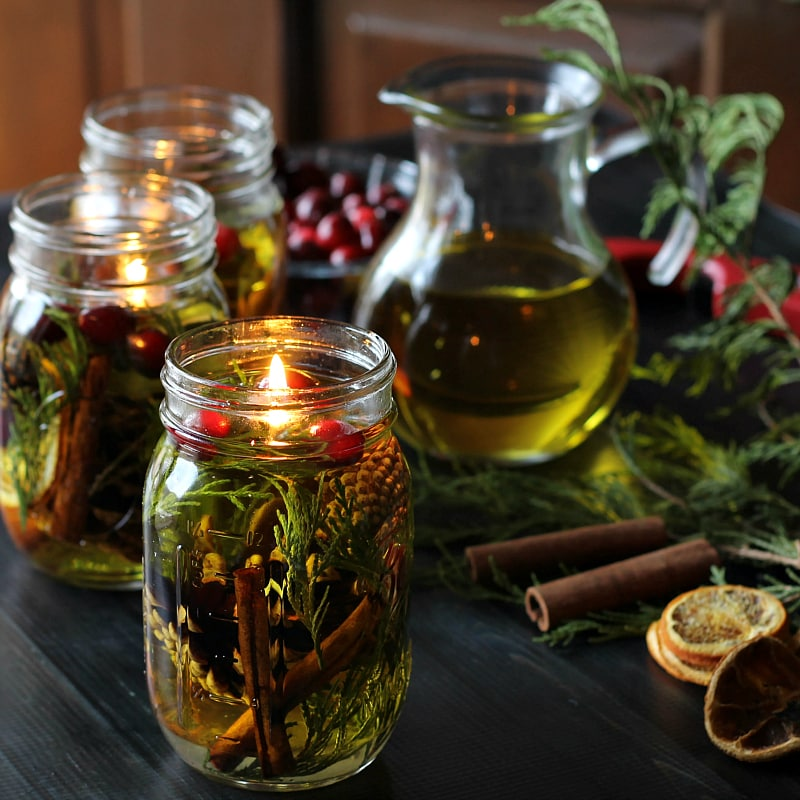 Mason Jar Oil Candle Lamp tutorial. Beautiful pine cones, evergreens and cinnamon sticks, combined with essential oils make great gifts for the holidays.