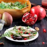 This recipe for a pear, pomegranate, & walnut salad is easy to make, and is paired with a tasty a pomegranate vinaigrette recipe that completes the dish.